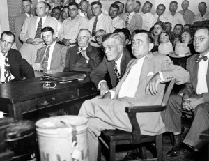 Gov. Coke Stevenson (holding cigar) at the hearing in Alice.